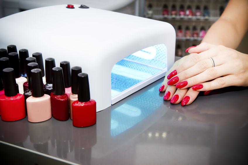 27145861 - manicure set in a beauty salon. beautiful female hands.
