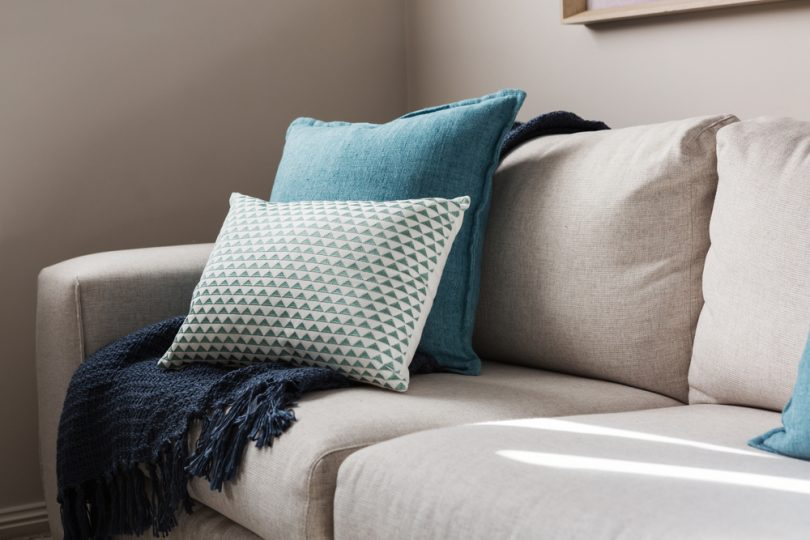 Close,Up,Of,A,Fabric,Sofa,With,Styled,Cushions,And