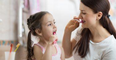 Mother,Teaching,Kid,Daughter,Teeth,Brushing,In,Bathroom