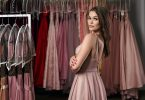 Model,Selecting,An,Outfit,For,Occasion,In,Dress,Hire,Service
