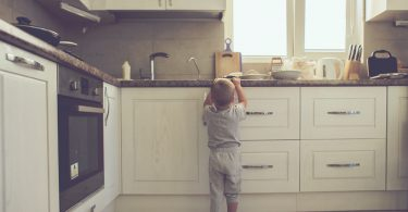 2,Years,Old,Child,Standing,On,The,Floor,Alone,In