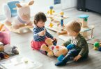 Cute,Little,Girl,And,Boy,Playing,With,Toys,By,The