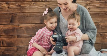 Photographer,In,Motion.,Young,Woman,Photographer,And,Children,Girls,Having